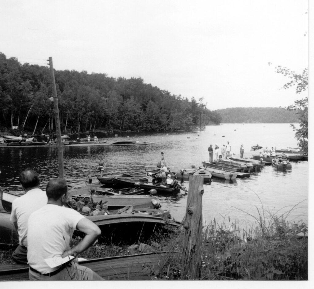 men looking at marina