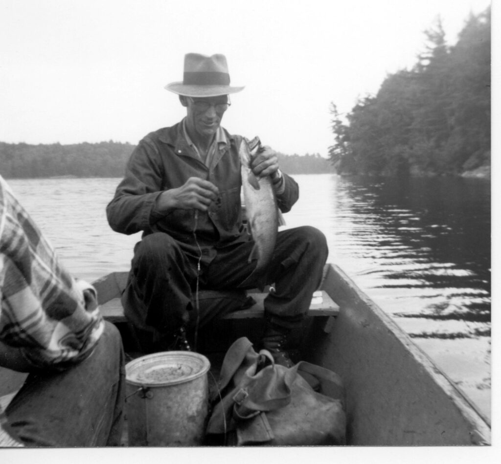 man with fish in fishing boat