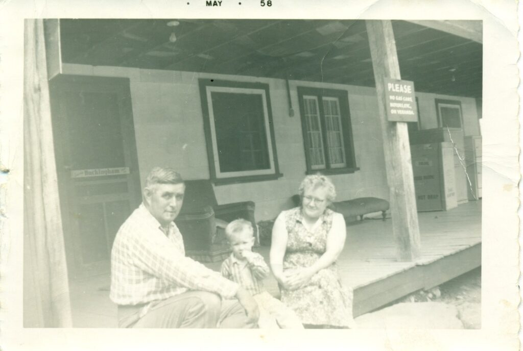 couple sitting on porch with child