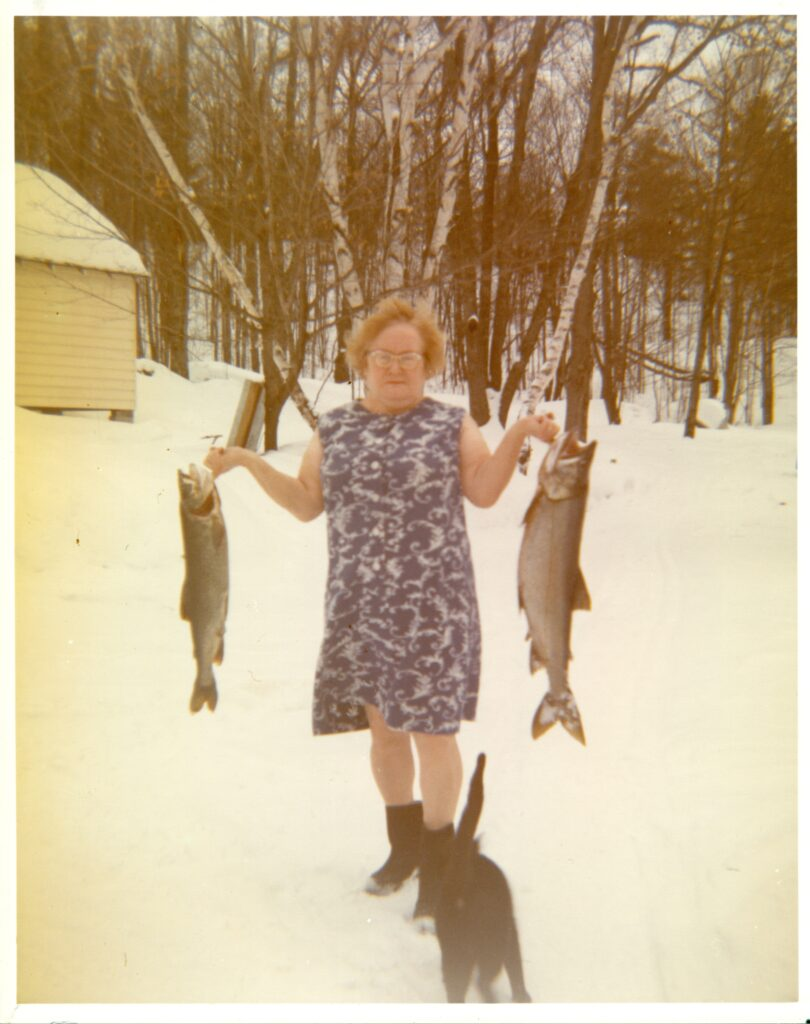 woman with fish and cat